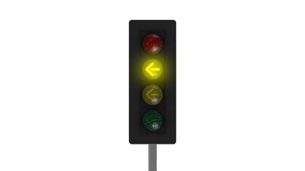 Ett trafikljus gul pil