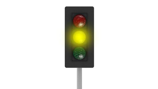Ett gult trafikljus